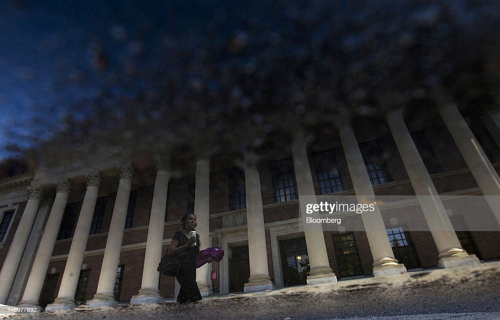 The Harry Elkins Widener Memorial Library is reflected in a puddle at Harvard University in Cambridge, Massachusetts, U.S., on Monday, Aug. 6, 2012. Harvard University, an American private Ivy League research university established in 1636, is the oldest institution of higher learning in the United States and the first corporation chartered in the country. Photographer: Brent Lewin/Bloomberg via Getty Images