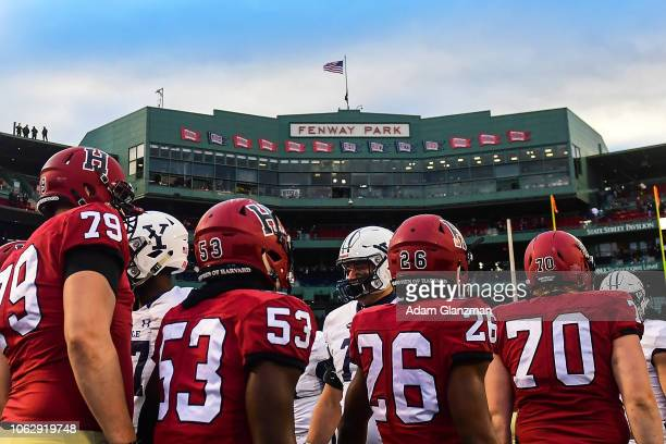The Harvard Crimson and the Yale Bulldogs shake hands after a game at Fenway Park on November 17 2018 in Boston Massachusetts