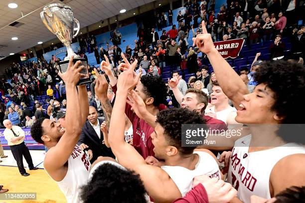 The Harvard Crimson celebrate their 83-81 win in overtime over the Columbia Lions to win the regular season IVY League title 1at Frances S. Levien...