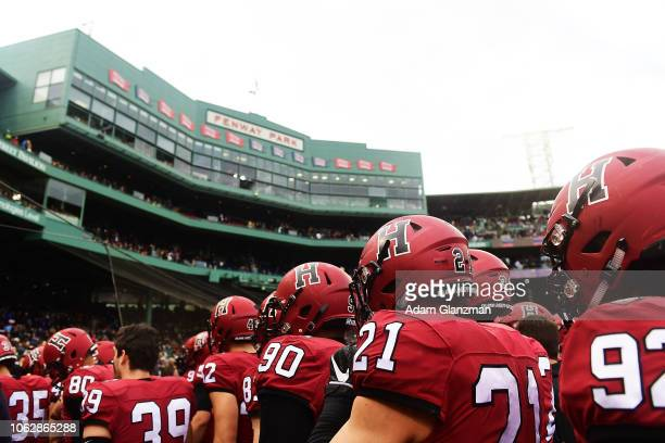 The Harvard Crimson head to the locker room at the end of the second half of a game against the Yale Bulldogs at Fenway Park on November 17, 2018 in...