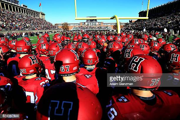 The Harvard Crimson huddle in the end zone before the game against the Yale Bulldogs at Harvard Stadium on November 19 2016 in Boston Massachusetts