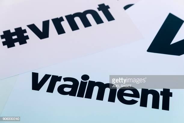The hashtag and logo of French new weekly 'Vraiment' are pictured in the weekly's newsroom on January 15 2018 in Paris The new generational 84pages...