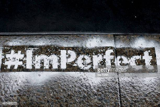The hashtag ImPerfect is seen at the Esprit store during the Vogue Fashion's Night Out on September 09 2015 in Berlin Germany