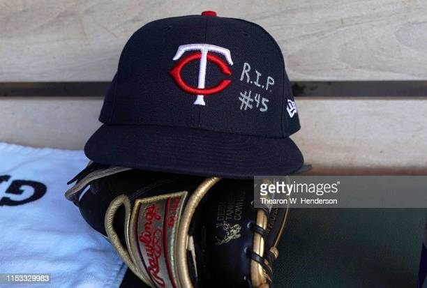 The hat belonging to Byron Buxton of the Minnesota Twins with the letters RIP written on the front of it sits in the dugout prior to the start of a...