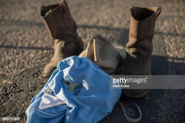 The hat boots and shirt of Fred Schneider of Charters Towers are seen in preparation for racing in the triathlon during the Dirt 'n' Dust Festival...