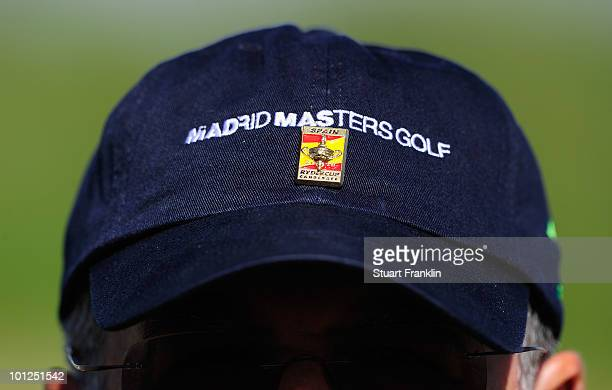 The hat of a marshall has a badge supporting the bid for Madrid to host the 2018 Ryder Cup during the third round of the Madrid Masters at Real...