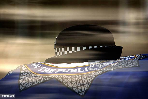 The hat of murdered Police Constable Sharon Beshenivsky is layed on top of her coffin a it leaves Bradford Cathedral on January 11 2006 in Bradford...