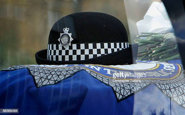 The hat of murdered Police Constable Sharon Beshenivsky is layed on top of her coffin as it leaves Bradford Cathedral on January 11 2006 in Bradford...