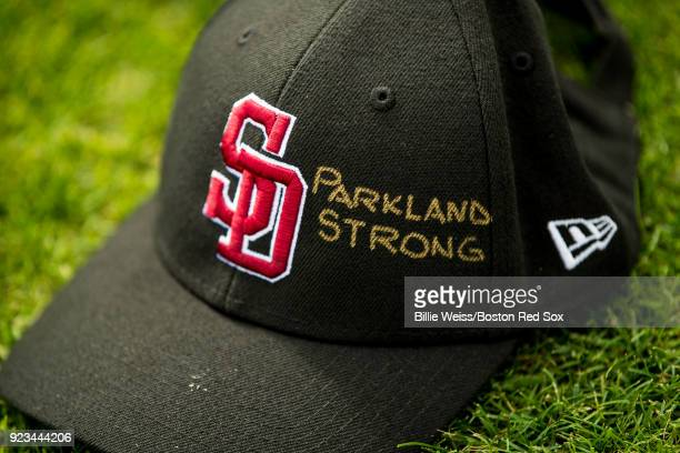The hat of the Marjory Stoneman Douglas High School Eagles baseball team is shown before a game between the Boston Red Sox and the Minnesota Twins at...