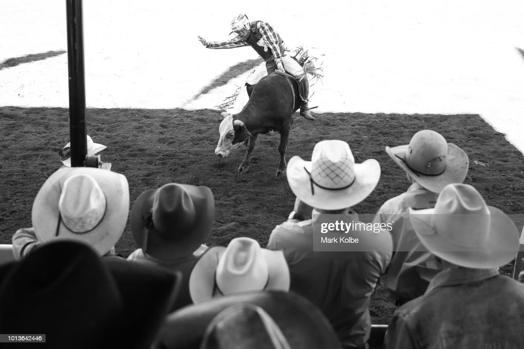 The hats of competitors and spectators are seen as they watch the actio in the junior bull ride competition during the Rodeo Sound Check of the 2018 Mount Isa Rotary Rodeo at the Buchanan Park Events Complex on August 9, 2018 in Mount Isa, Australia. Established in 1959, the Mount Isa Rodeo is the richest in the southern hemisphere and attracts contestants from all parts of the world.