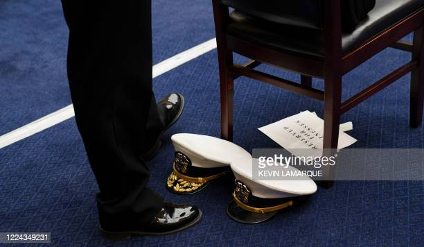 The hats of Pentagon Supply Chain Stabilization Task Force Vice Director of Logistics Rear Admiral John Polowczyk and US Assistant Secretary for...