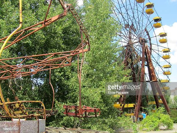 CONTENT] The haunting remains of an amusement park in the former Soviet town of Pripyat Ukraine abandoned after the April 12 1986 nuclear disaster at...