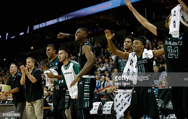 The Hawaii Warriors bench celebrates a score against the California Golden Bears in the first half during the first round of the 2016 NCAA Men's...