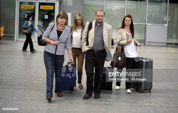 The Hawker family of Lindsay Ann Hawker who was murdered in Japan, mother Julia, sister Lisa, father Bill and sister Louise, arrive at Terminal 3 of...