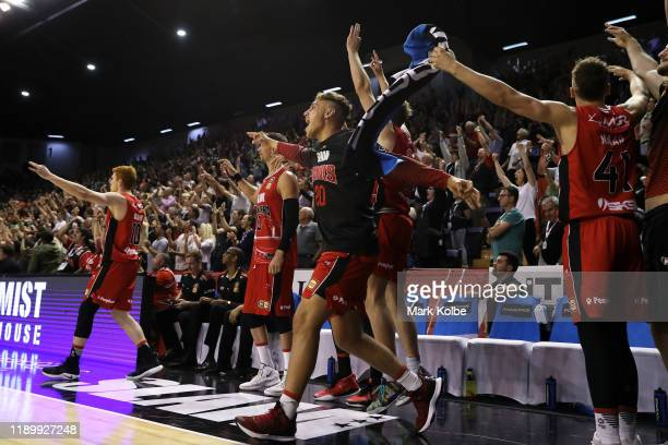The Hawks bench celebrate during their overtime win in the round 8 NBL match between the Illawarra Hawks and the Cairns Taipans at WIN Entertainment...