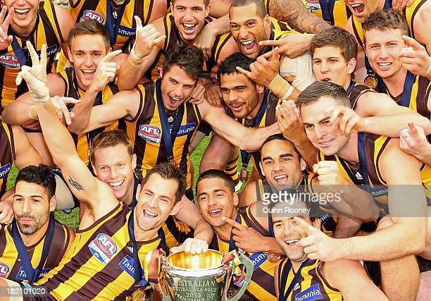 The Hawks celebrates with the Premiership Cup after winning the 2013 AFL Grand Final match between the Hawthorn Hawks and the Fremantle Dockers at...