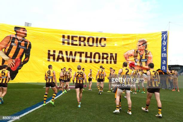 The Hawks head out for the round 21 AFL match between the Hawthorn Hawks and the North Melbourne Kangaroos at University of Tasmania Stadium on...