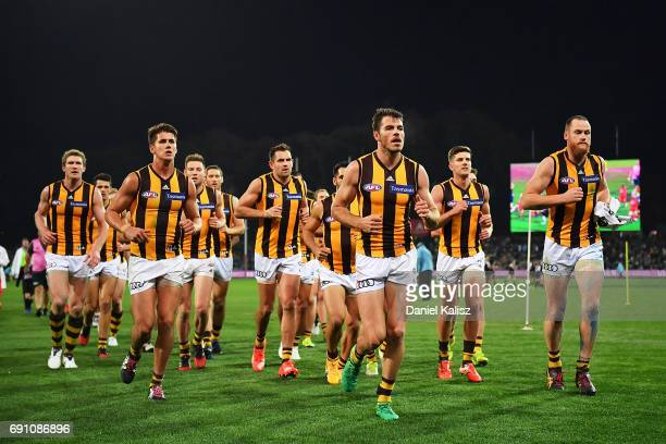 The Hawks players run from the field at half time during the round 11 AFL match between the Port Adelaide Power and the Hawthorn Hawks at Adelaide...