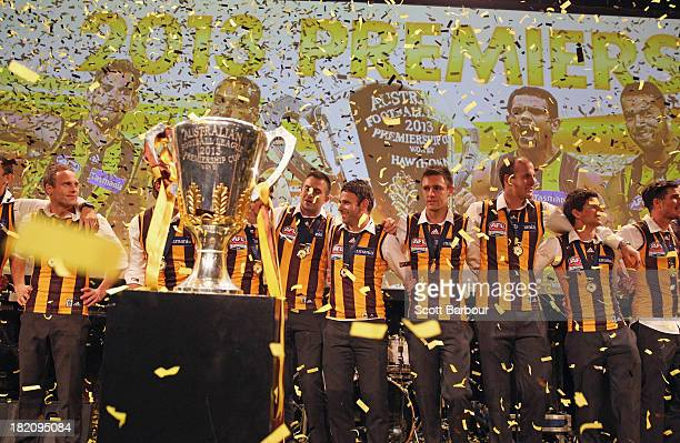 The Hawks sing the team song as confetti falls during the Hawthorn Hawks AFL Grand Final post match function at Crown Palladium on September 28 2013...