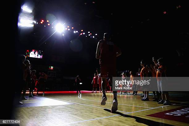 The Hawks take the court during the round nine NBL match between the Illawarra Hawks and the Sydney Kings at the Wollongong Entertainment Centre on...