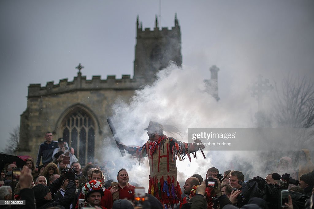 The Haxey Fool, Dale Smith, delivers his speech during the 'Smoking of the Fool' as he starts the Haxey Hood at Haxey Village on January 6, 2017 in Doncaster, England. The origins of the ancient game of Haxey Hood goes back hundreds of years to the 14th century. Lady de Mowbray was out riding towards Westwoodside on the hill that separates it from the village of Haxey, when her silk riding hood was blown away by the wind, farm workers in the field rushed to help and chased the hood eventually it was caught by one of the men, but being too shy to hand it back to the lady, he gave it to one of the others to hand back to her. She thanked the farm worker who had returned the hood and said that he had acted like a Lord, whereas the worker who had actually caught the hood was a Fool. The act of chivalry and the resulting chase amused her so much she donated 13 acres of land on condition that the chase for the hood would be re-enacted each year.