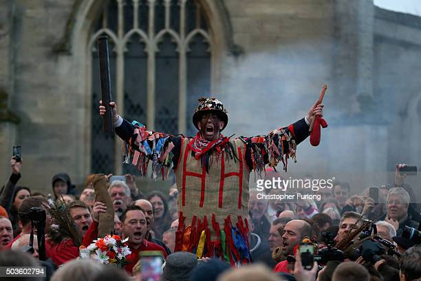 The Haxey Fool Dale Smith is smoked as he starts the Haxey Hood at Haxey Village on January 6 2016 in Doncaster England The origins of the ancient...