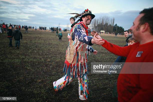 The Haxey Fool Dale Smith shakes hand with a Boggin at the start of the Haxey Hood at Haxey Village on January 6 2011 in Doncaster England The...