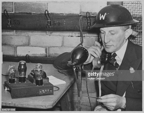 The head air raid patrol warden of Sheffield conducts a training game of darts for the other wardens The game is a kind of mockup of a real air raid