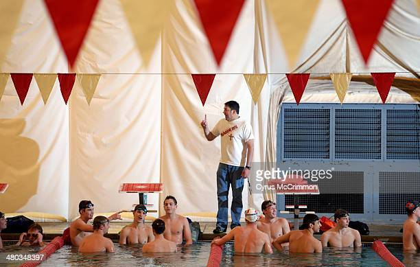 The head coach for boys swimming Nick Frasersmith at Regis Jesuit High School talks to the team during practice on Friday March 21 2014 Frasersmith...