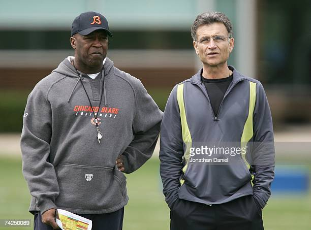 The head coach Lovie Smith and general manager Jerry Angelo of the Chicago Bears look over players during a rookie mini-camp practice at Halas Hall...