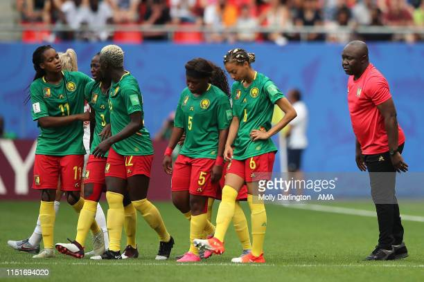 The head coach / manager of Cameroon Alain Djeumfa attempts to calm down his players after VAR frustration during the 2019 FIFA Women's World Cup...