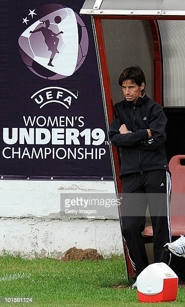 The head coach of Germany Bettina Wiegmann watches her players against France during the UEFA Women's Under19 European Championship semifinal match...