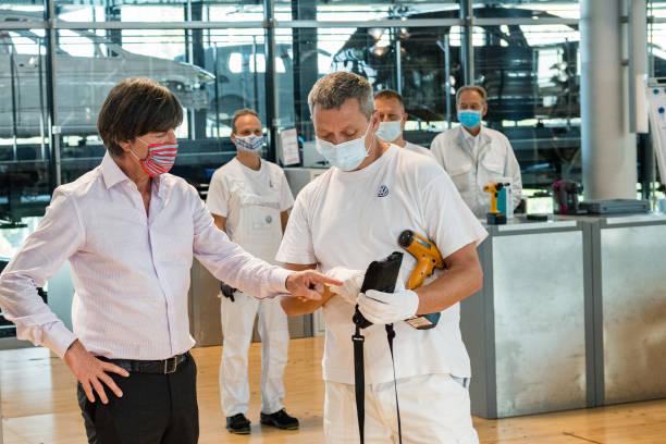 DEU: Joachim Loew Visits Glaeserne Manufaktur By Volkswagen