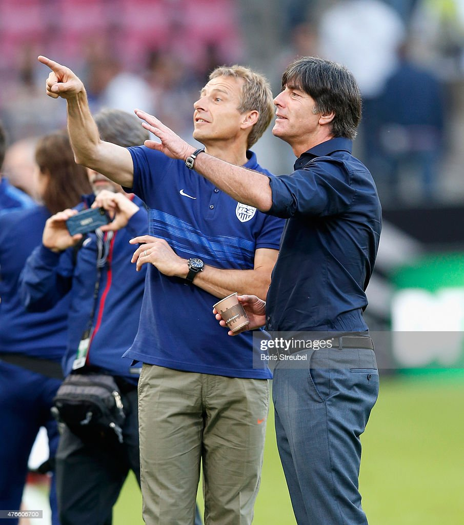 The head coach of the USA, Juergen Klinsmann and Joachim Loew , head coach of Germany react during the International Friendly match between Germany and USA at RheinEnergieStadion on June 10, 2015 in Cologne, Germany.
