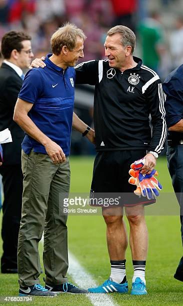 The head coach of the USA Juergen Klinsmann Andreas Koepke goalkeeper coach of Germany hug prior to the International Friendly match between Germany...