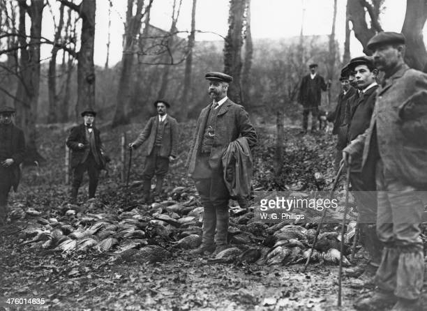 The head gamekeeper and his men with the day's kill from a pheasant shoot at Warter Priory East Yorkshire December 1910