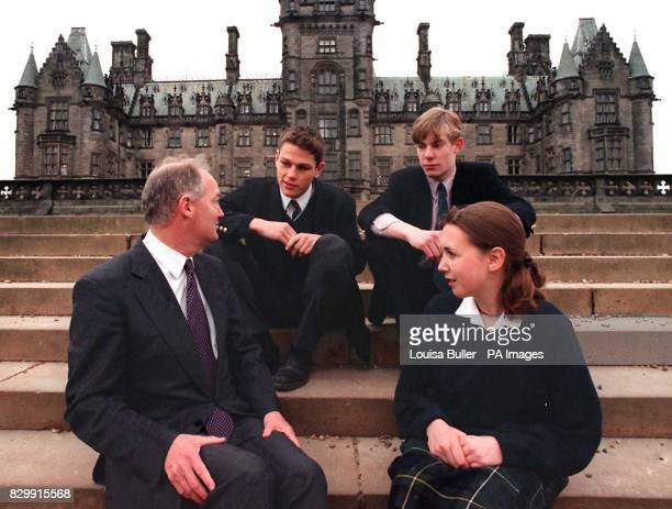 The Head master of Tony Blair's old school Fettes College in Edinburgh sits with pupils in front of the main school building Clockwise from from left...