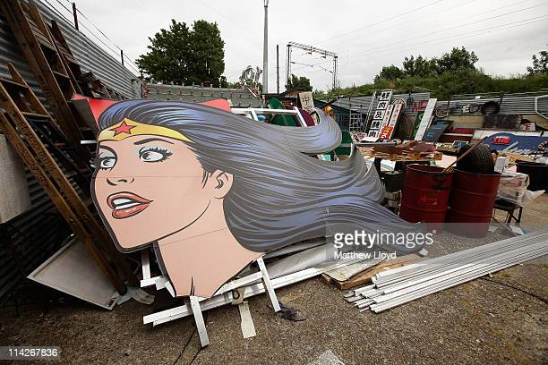 The head of a 60ft 'Wonder Woman' produced for a MAC makeup advert lies in artist Chris Bracey's yard on May 16 2011 in London England He has been...