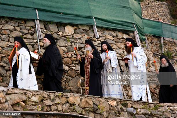 The head of a Osiou Gregoriou monastery Igumen Christophoros followed by Monks and Orthodox Christian worshippers during the Easter Monday Litany in...