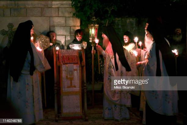 The head of a Osiou Gregoriou monastery Igumen Christophoros holds a candle with Holy flame during the Easter Sunday Mass at the Osiou Gregoriou...
