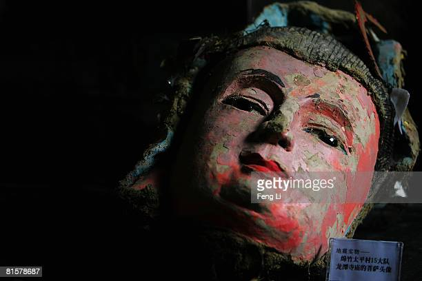 The head of Bodhisattva damaged during the May 12 earthquake is displayed at Jianchuan Museum on June 15 2008 in Dayi county of Sichuan Province...