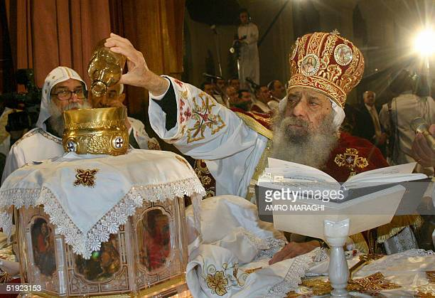 The head of Egypt's Coptic Church Pope Shenuda III celebrates midnight mass marking Orthodox Christmas at Saint Marc Cathedral in Cairo late 06...