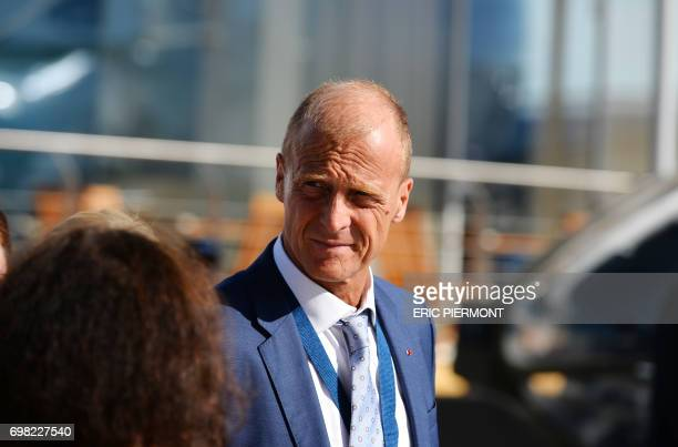 The head of European aerospace giant Airbus Group Tom Enders walks on the tarmac at the Airbus pavillon at Le Bourget on June 20 2017 during the...