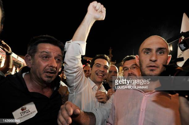 The head of Greece's Syriza party the secondlargest after the May 6 2012 election Alexis Tsipras celebrates with supporters in the center of Athens...