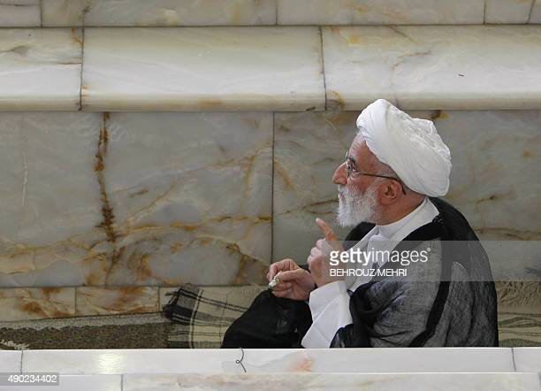 The head of Iran's electoral body the Guardians Council Ahmad Jannati perfumes himself before leading the weekly Friday prayers at Tehran university...
