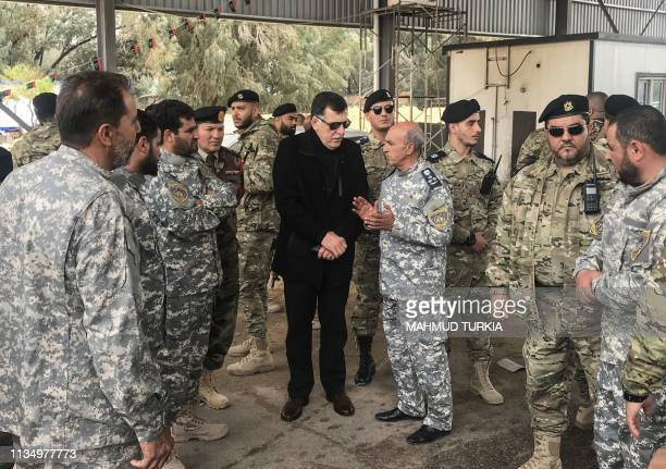 The head of Libya's UNbacked unity government Fayez alSarraj visits military and security commanders of the government forces who supervised...