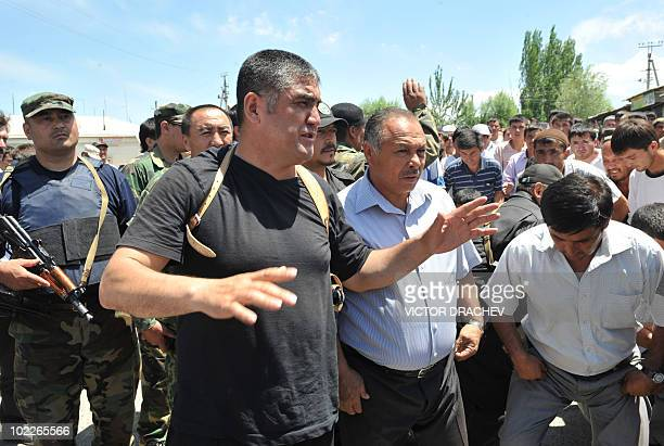 The head of local police, colonel Kursan Asanov , speaks to ethnic Uzbek Kyrgyzs during peace negotiations asking ethnic Uzbeks to pull down a...