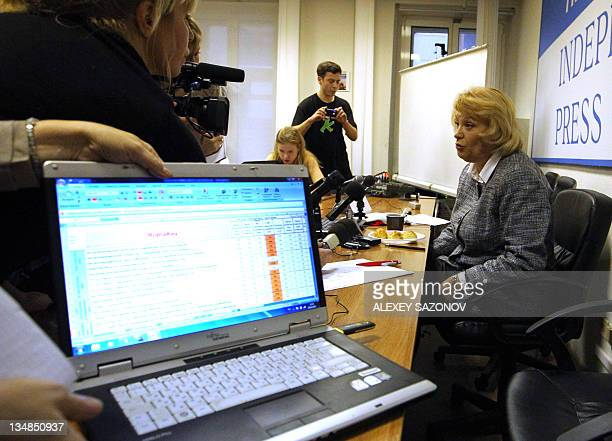 The head of Russia's of leading independent election watchdog Golos Liliya Shibanova speaks to the journalists in Moscow on December 4 during...