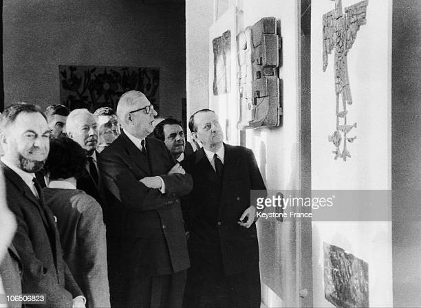The Head Of State And The Minister For Cultural Affairs Before Some Works Of BeauxArts Students Inaugurating The Culture House In Bourges