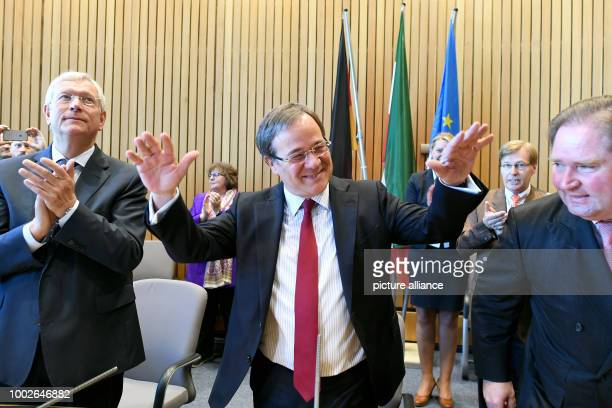 The head of the CDU in the state of North RhineWestphalia Armin Laschet celebrates with supporters in Duesseldorf Germany 16 May 2017 Laschet will in...